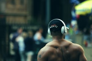 man wearing headphones for working out